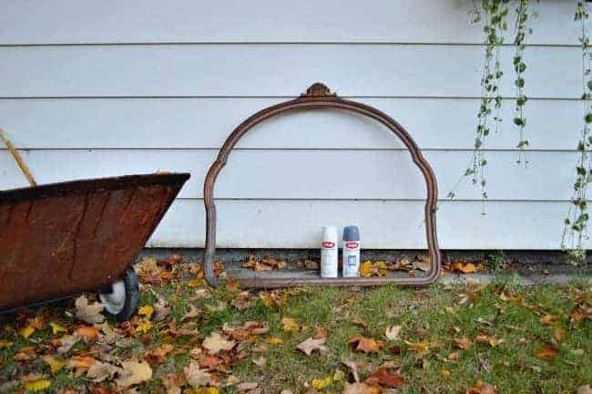 Vintage mirror frame and two cans of spray paint