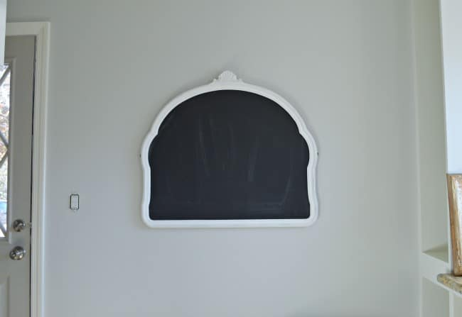 kitchen chalkboard hanging on a gray painted kitchen wall