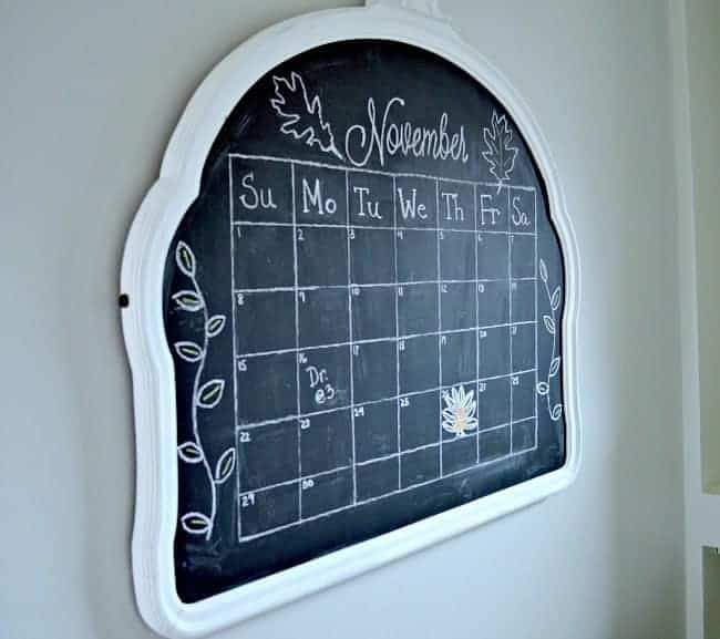 Vintage mirror turned into a kitchen chalkboard with a monthly calendar