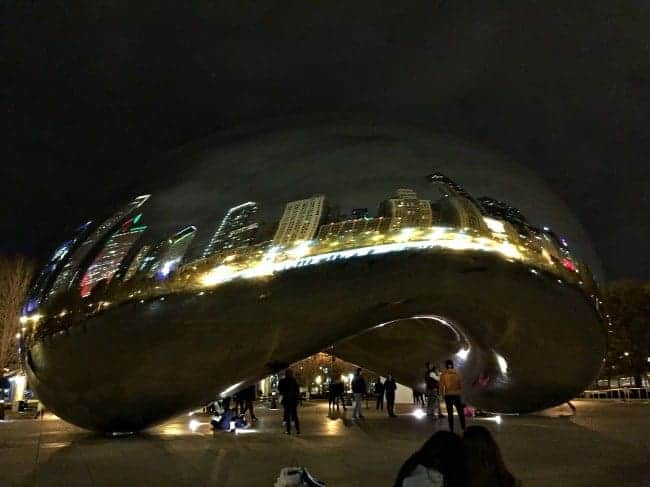 The Chicago Bean reflecting the nighttime skyline. | chatfieldcourt.com