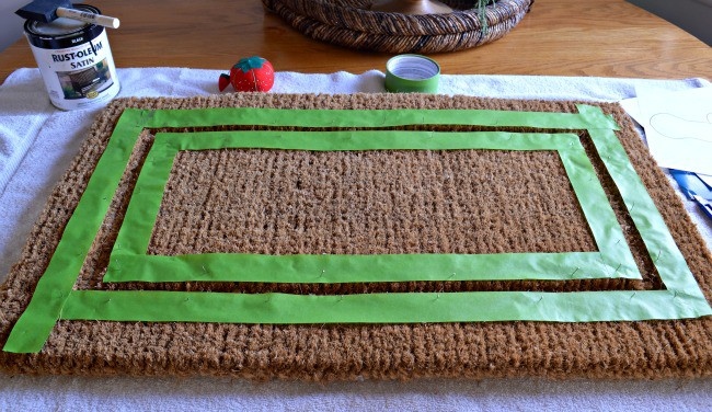 DIY deer head doormat prepping with painter's tape. | www.chatfieldcourt.com
