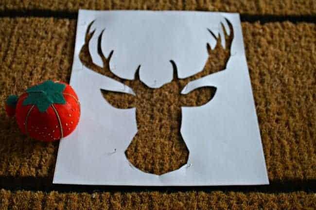 DIY deer head doormat deer head stencil pinned to mat. | www.chatfieldcourt.com
