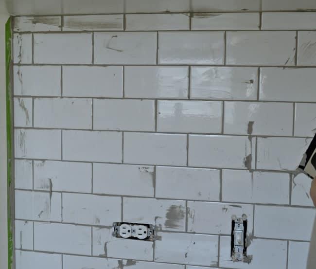 Kitchen Reno Update: Subway Tile Backsplash grouting the tile   chatfieldcourt.com