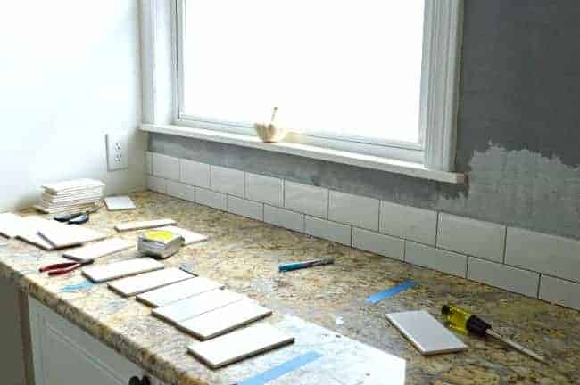 Kitchen Reno Update: Subway Tile Backsplash tile going up | chatfieldcourt.com