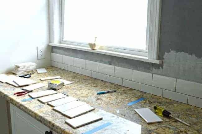 Kitchen Reno Update: Subway Tile Backsplash tile going up   chatfieldcourt.com