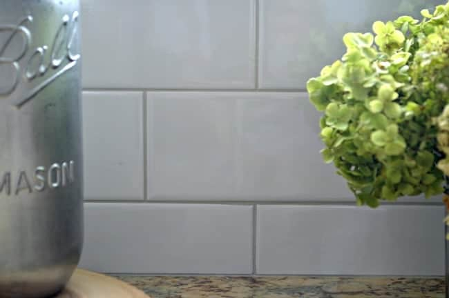 Kitchen Reno Update: Subway Tile Backsplash with warm gray grout on window wall| chatfieldcourt.com