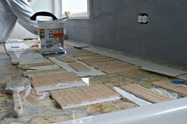 Kitchen Reno Update: Subway Tile Backsplash tiling the wall   chatfieldcourt.com