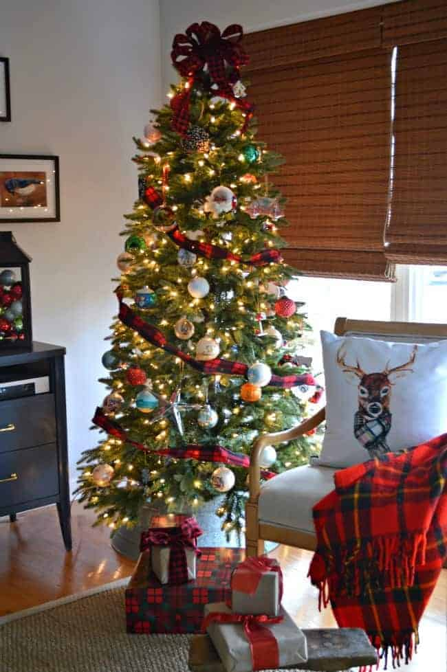 A Christmas living room tree with plaid and red. | chatfieldcourt.com