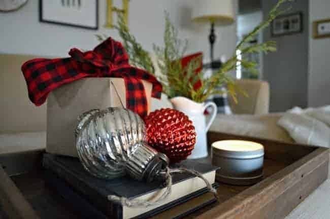 A Christmas living room decorated with lots of plaid, red, candles and greenery. | www.chatfieldcourt.com
