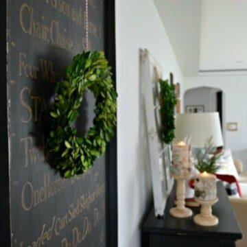 small wreath hanging on picture
