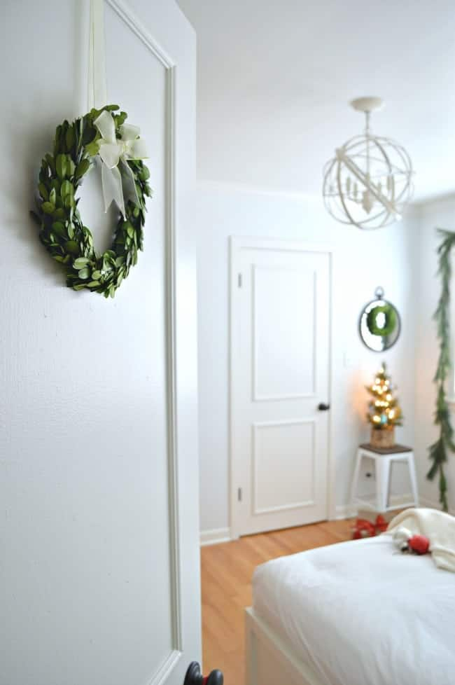 Christmas in the guest bedroom using green velvet on the platform bed and fresh greens | chatfieldcourt.com