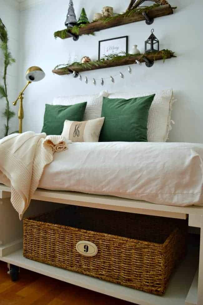 Christmas in the guest bedroom using green velvet on the platform bed, fresh greens and a DIY lightbulb banner | chatfieldcourt.com