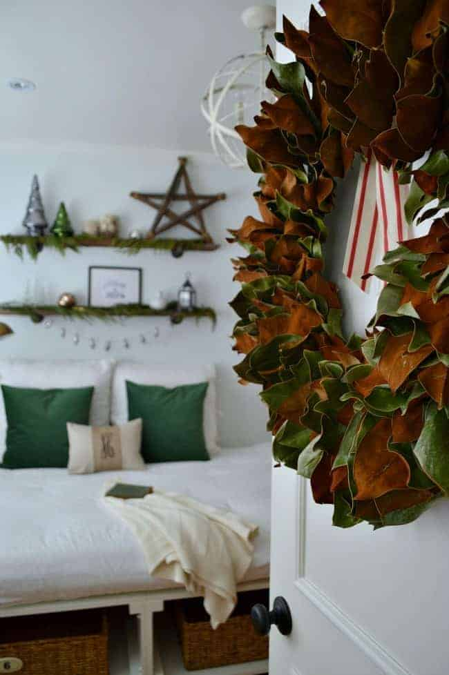 Christmas in the guest bedroom using green velvet, fresh greens and a magnolia wreath | chatfieldcourt.com