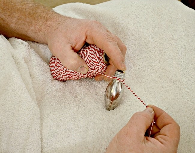 tying a light bulb with baker's twine