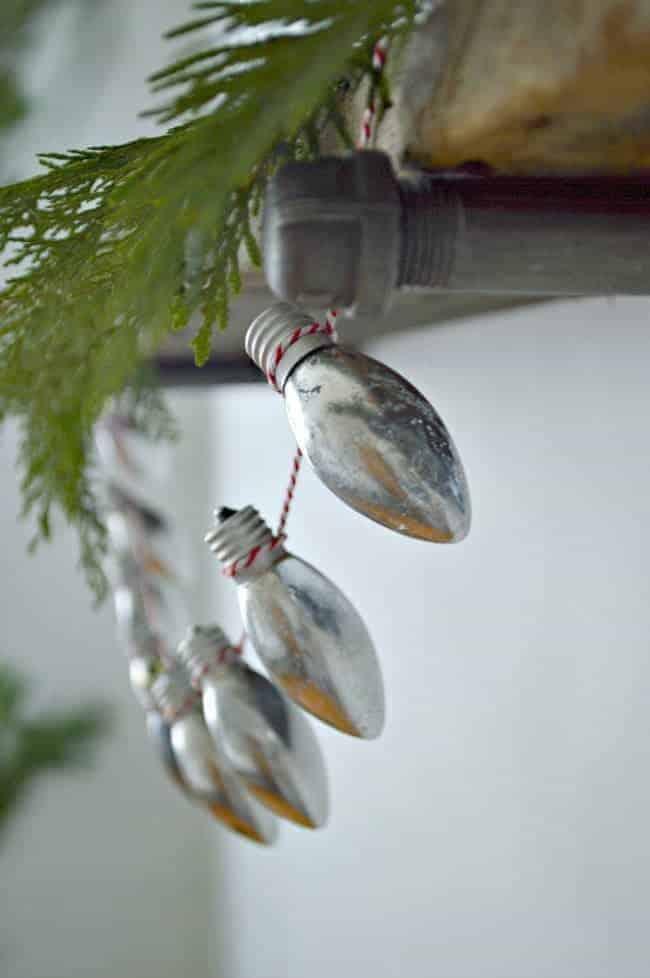 diy Christmas lightbulb banner on wood shelf