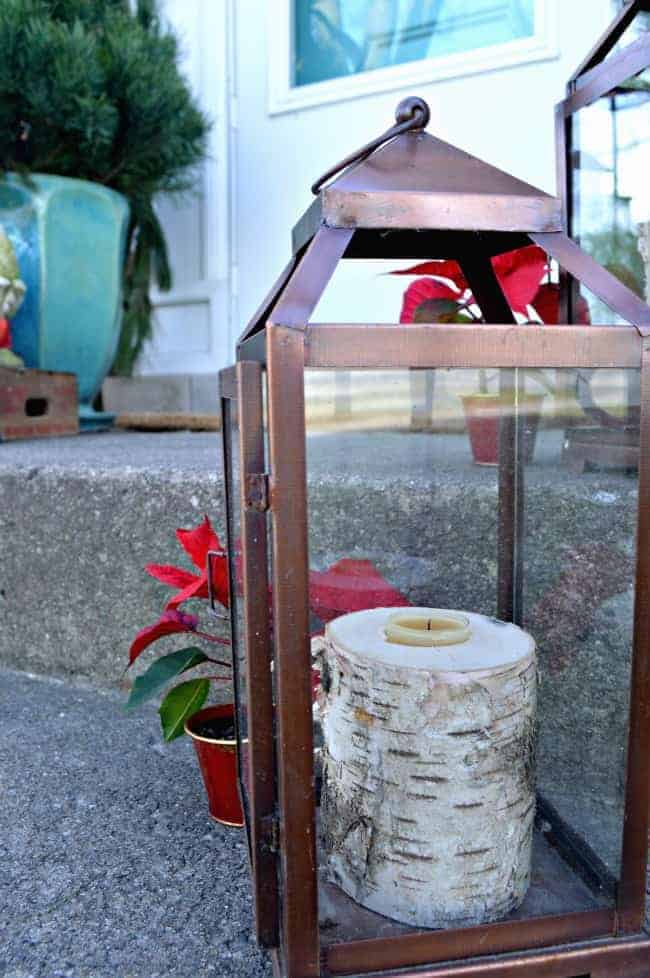 Christmas on our small front porch, which is decorated with birch log candle holders and greens | chatfieldcourt.com