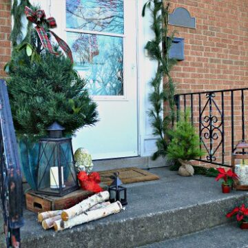 A small front porch decorated for Christmas