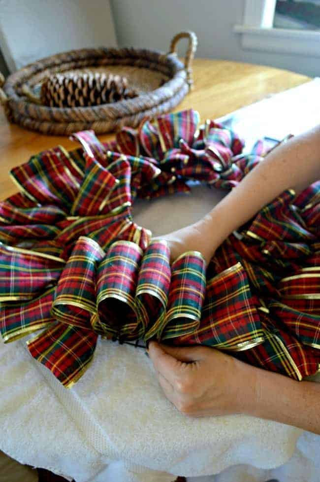 Make a ribbon wreath by looping plaid ribbon on a wire frame | chatfieldcourt.com