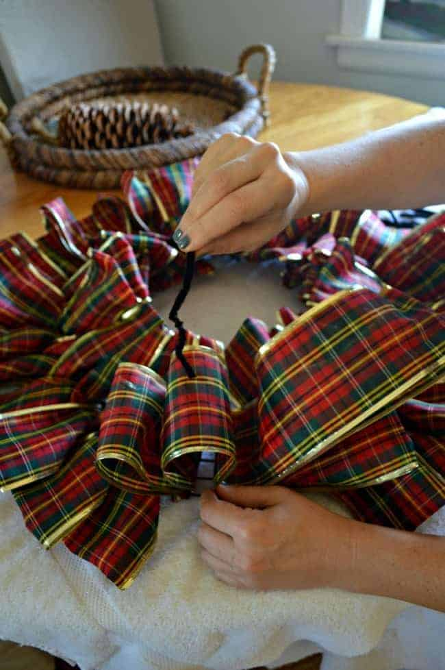 Make a ribbon wreath by tying plaid ribbon on a wire frame with pipe cleaners | chatfieldcourt.com