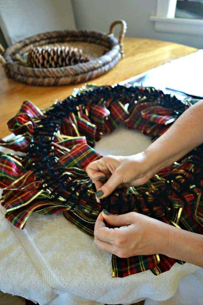 Tutorial on how to make a ribbon wreath by tying plaid ribbon on a wire frame with pipe cleaners | chatfieldcourt.com
