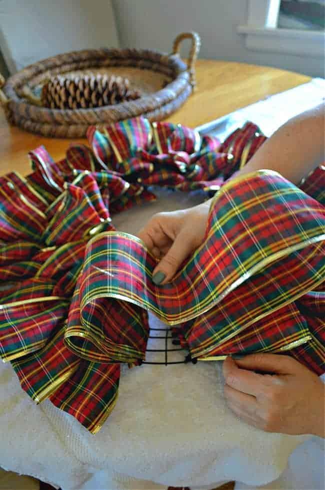tucking in ribbon on DIY ribbon wreath