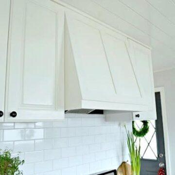 white painted cabinets and custom range hood