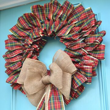 ribbon wreath hanging on turquoise front door