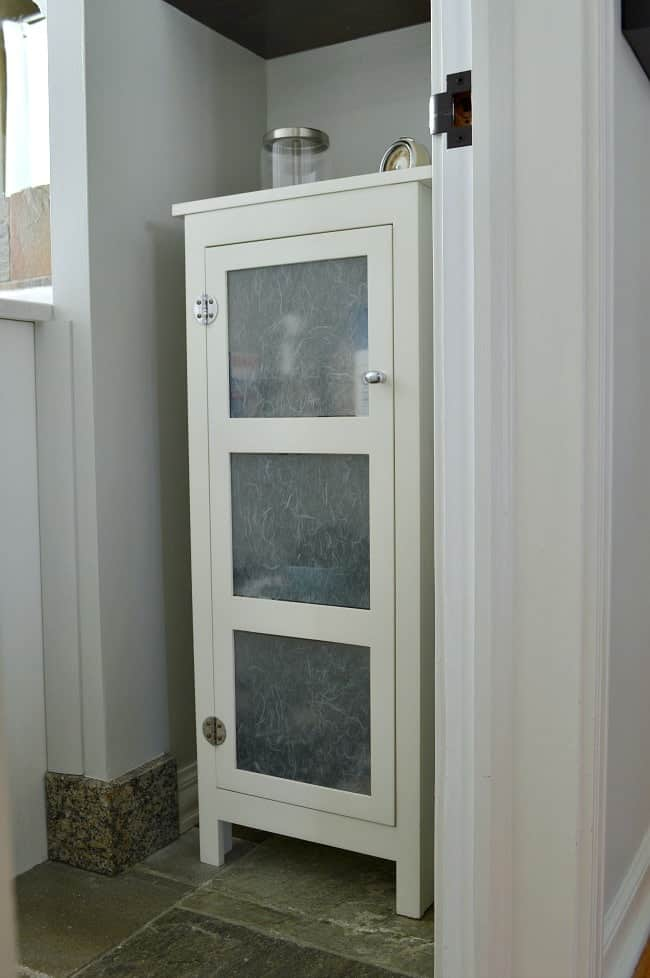Adding a small storage cabinet can help with bathroom organization