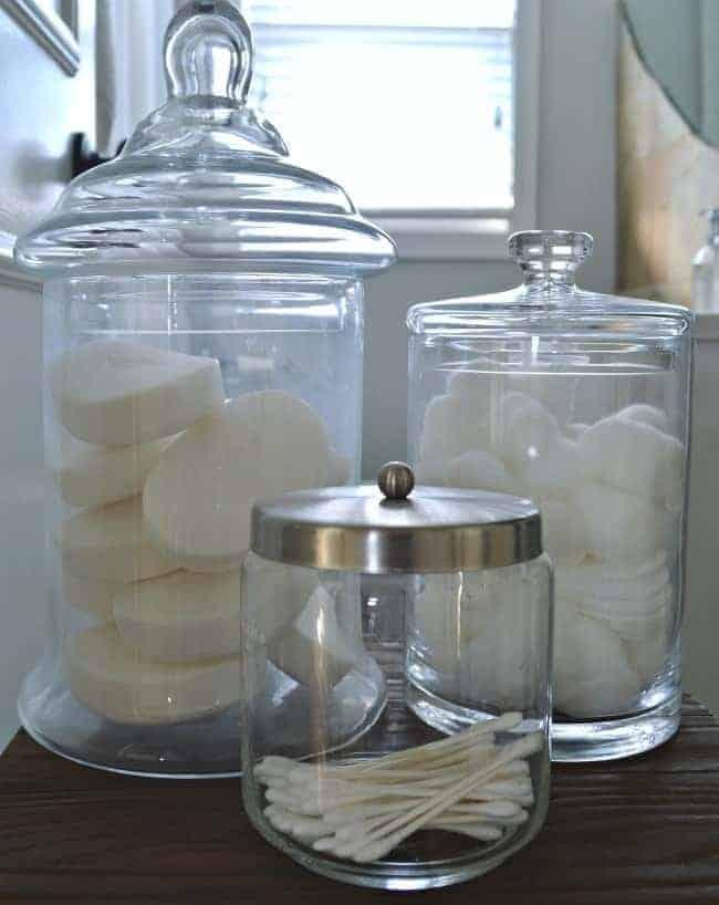 Using glass apothecary jars helps with bathroom organization | chatfieldcourt.com