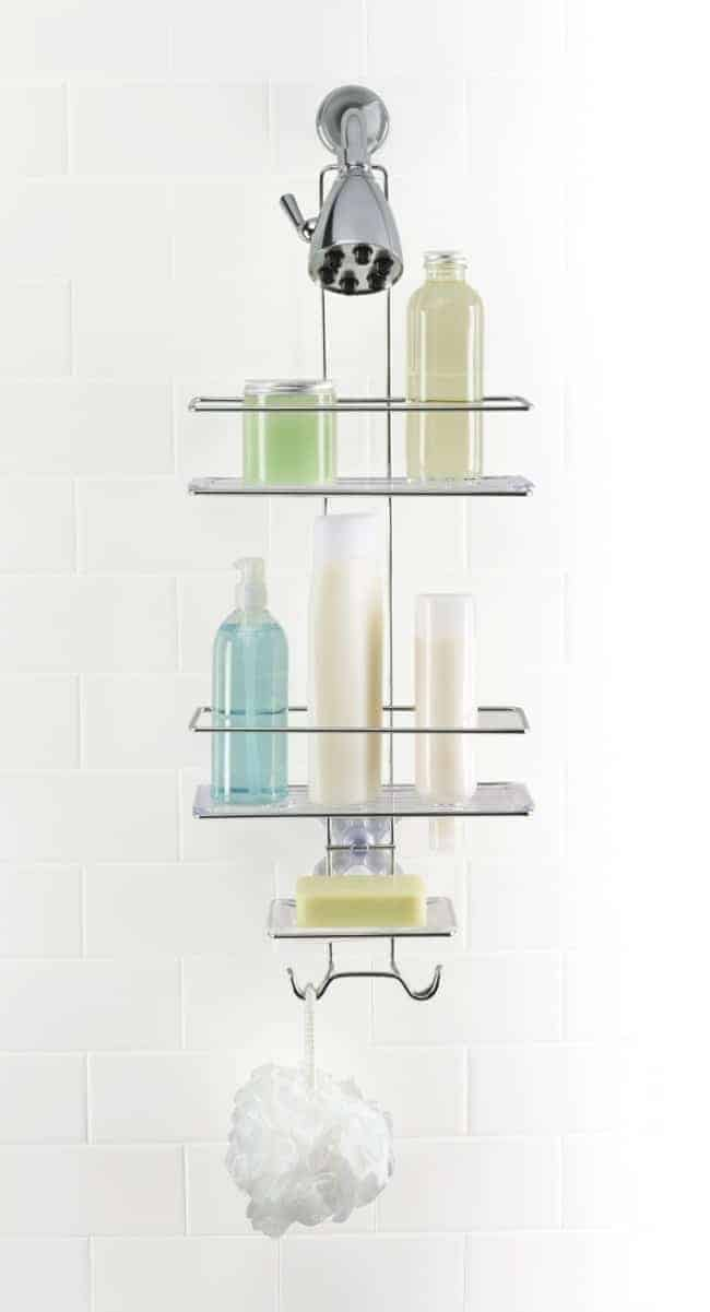 soaps and shampoos on shower caddy in white tiled shower