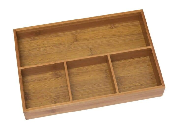 A bamboo tray used in vanity drawers helps with bathroom organization |
