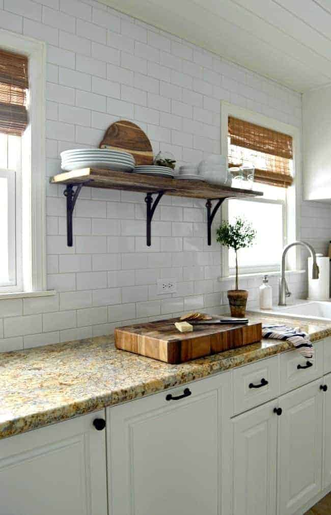 How we installed a rustic barn wood shelf on a tiled backsplash to add extra storage in a small kitchen.   chatfieldcourt.com