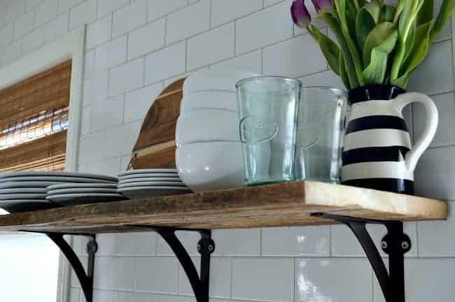 Install a rustic barn wood shelf to add extra storage in a small kitchen.   chatfieldcourt.com