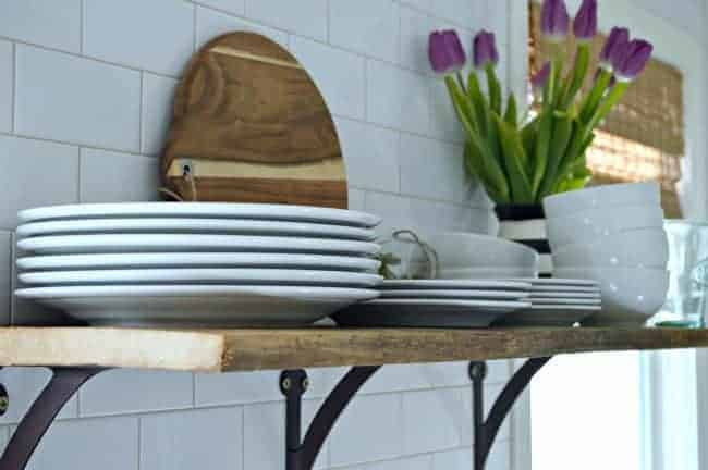 Install a rustic barn wood shelf to add extra storage in a small kitchen. | chatfieldcourt.com