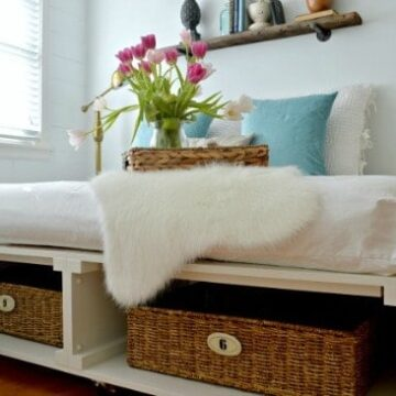 A bedroom with a platform bed