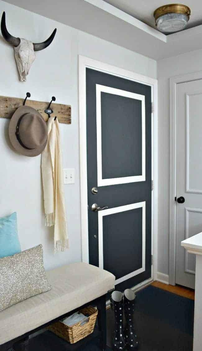 small entryway with gray door