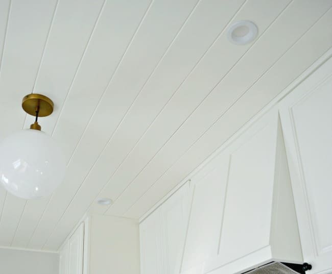 kitchen plank ceiling painted white and ceiling pendant
