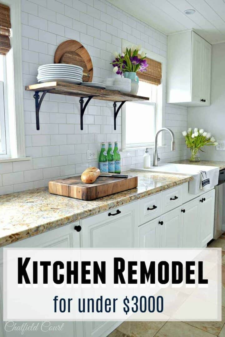 white galley kitchen counter with thick butcher block cutting board on counter