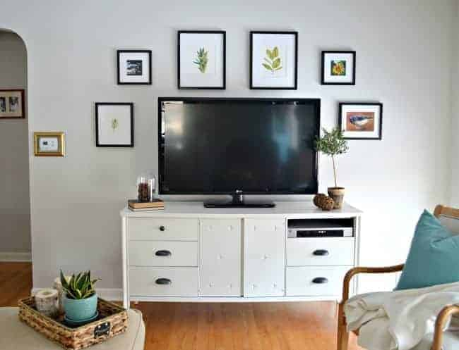 Giving a media cabinet a makeover using Benjamin Moore White Dove and cup pulls from Lowes. | chatfieldcourt.com