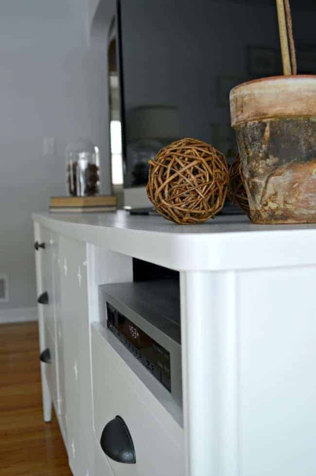 Using Benjamin Moore White Dove and cup pulls from Lowes to give a vintage dresser turned media cabinet a makeover. | chatfieldcourt.com