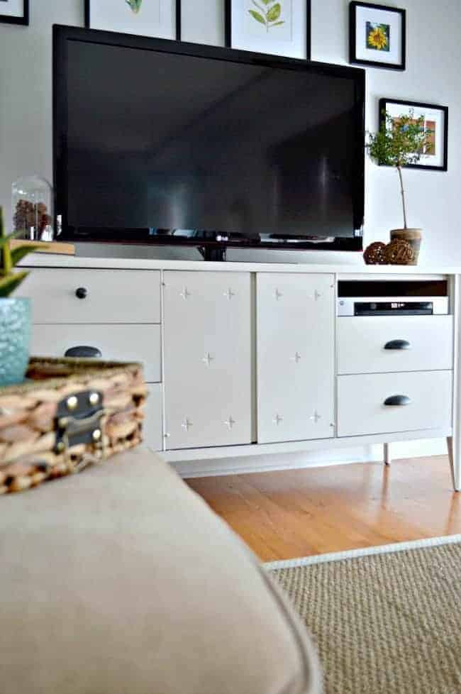 Giving a vintage dresser turned media cabinet a makeover using Benjamin Moore White Dove and cup pulls from Lowes. | chatfieldcourt.com