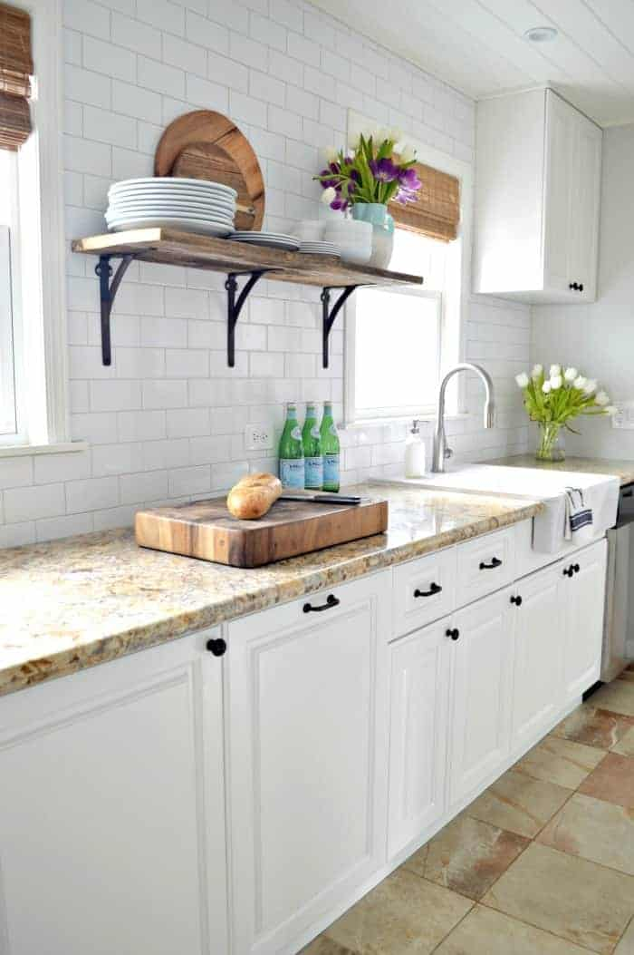 Turning a small, dark galley kitchen into a light, bright space. Get all of the kitchen remodel details from paint colors to tile and countertops.| chatfieldcourt.com