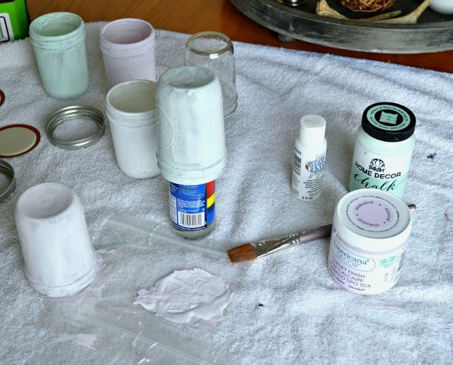 painting small mason jars with pastel chalk paint