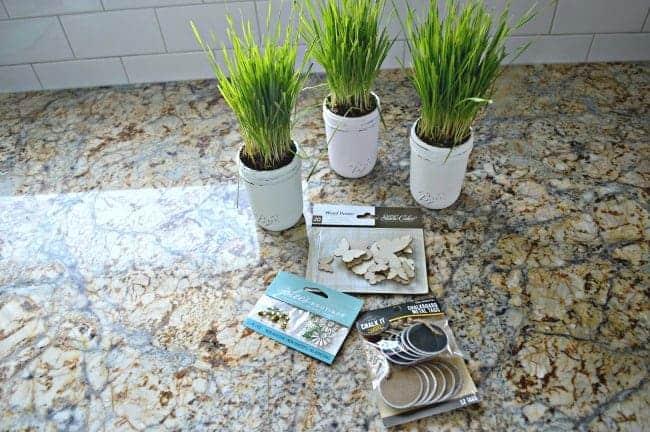 An easy DIY making spring mason jars using chalk paints, wheat grass and tags. | chatfieldcourt.com