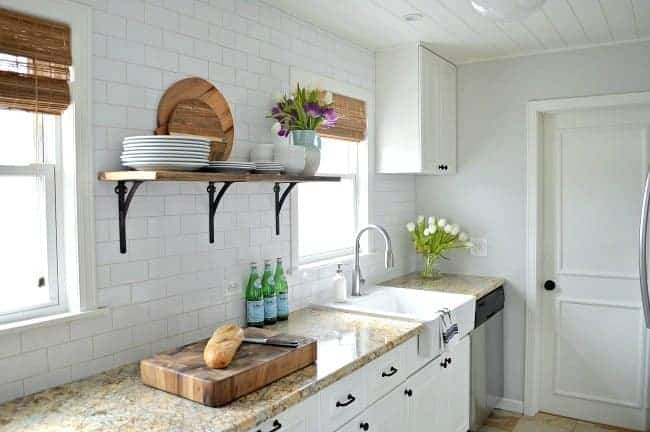Reveal of a small and dark kitchen turned into a white and bright space with tons of storage.