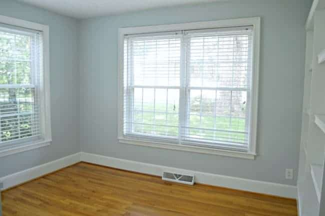 empty guest bedroom painted light blue