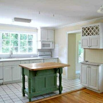 A kitchen with a green island
