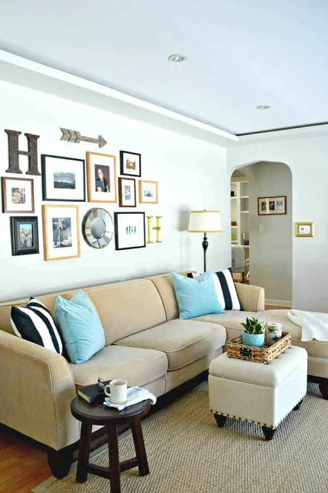 light beige sectional sofa with turquoise pillows and black and white striped pillows