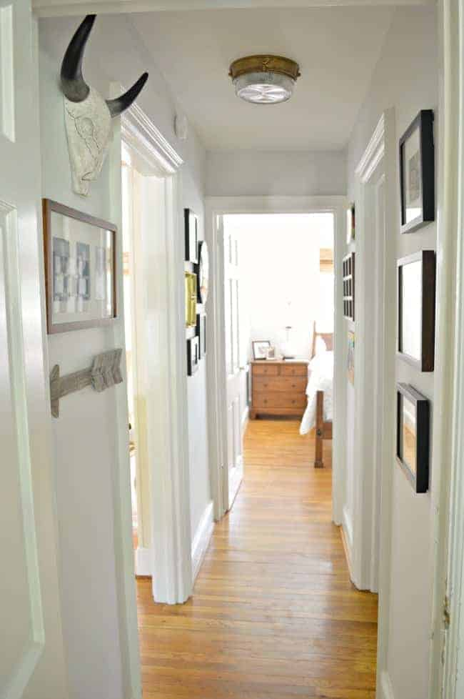 A small hallway redo using gray paint, a bit of farmhouse decor and family photos. www.chatfieldcourt.com