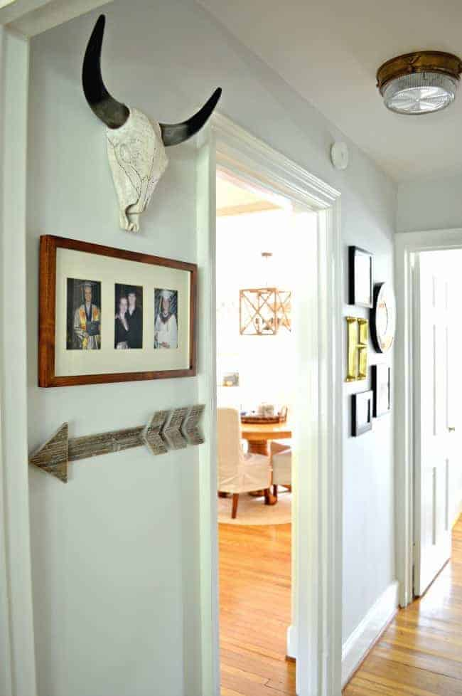 A small hallway redo using gray paint, some farmhouse decor and lots of family photos. chatfieldcourt.com